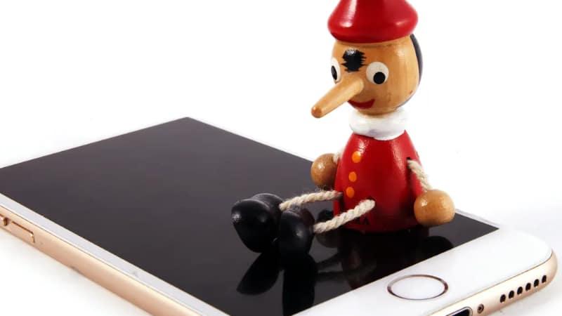 wood doll on phone