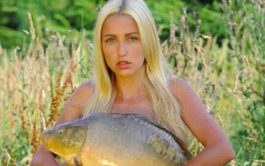 woman holding carp