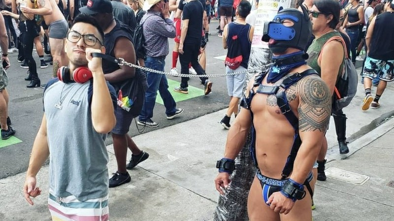 Man leading other man with leash